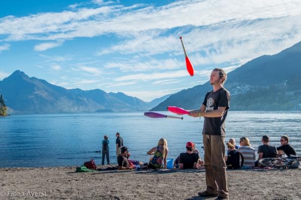 juggler on the beach in queenstown